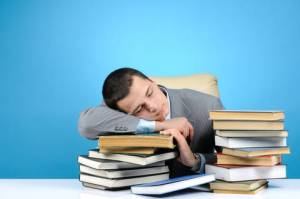 Photo of a Man Sleeping on Books