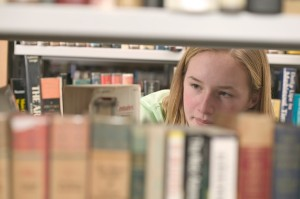 Girl Browsing Books at the Library