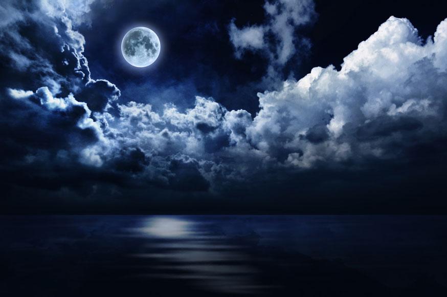 Full Moon In Night Sky Over Water